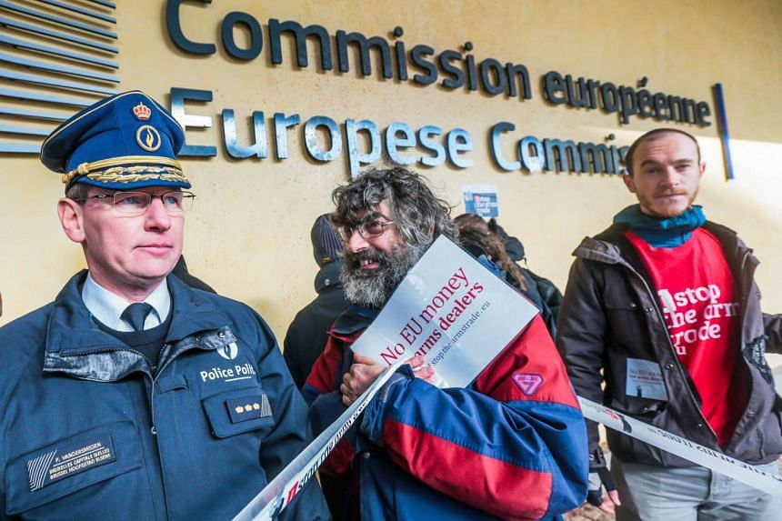 Police intervene when activists block the entrance of the European Commission while they protest in front of the building of the European Commission against the subsidies of Europe in the armaments industry in Brussels, Belgium, on Nov 10, 2016.