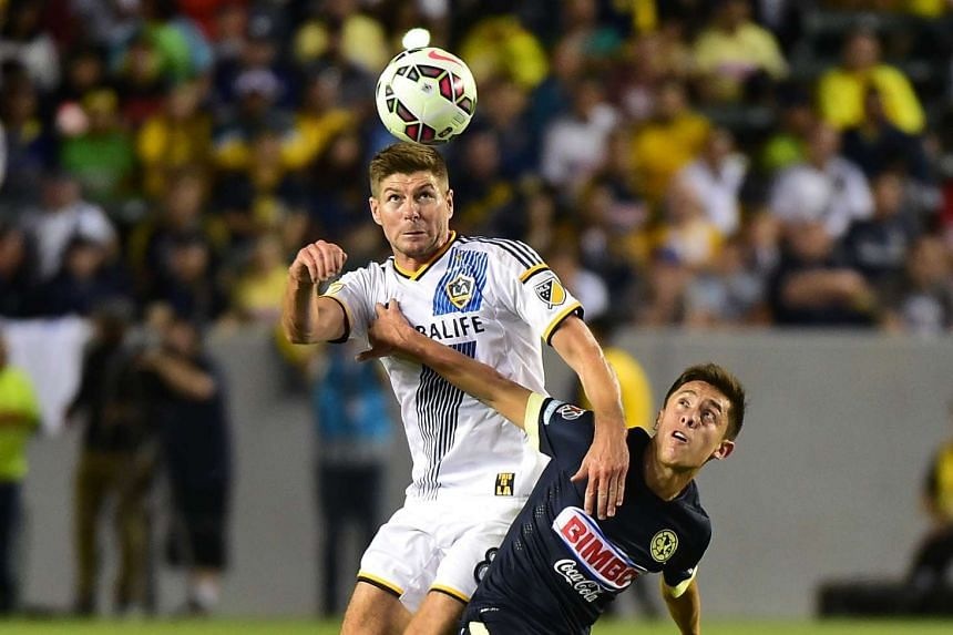 A 2015 file photo shows Steven Gerrard (left) in action for LA Galaxy.