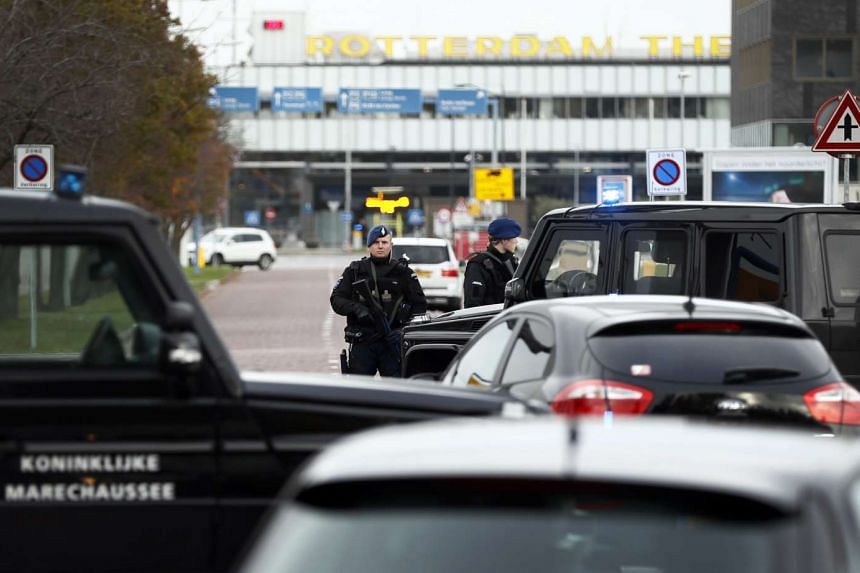 Dutch military police carry out controls at the entrance to Rotterdam Airport in Rotterdam on Nov 17, 2016, after receiving an anonymous tip-off about a possible terror threat.