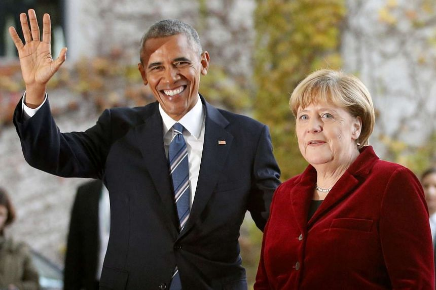 Merkel welcomes Obama upon his arrival at the chancellery in Berlin, Nov 17, 2016.