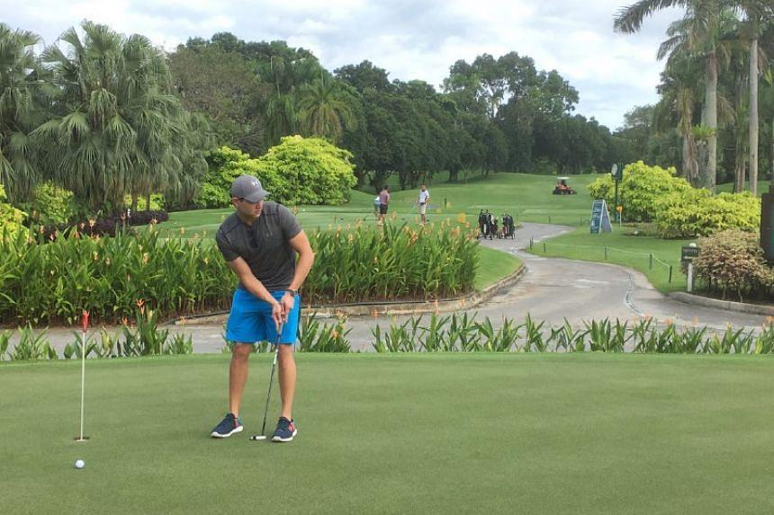 Joseph Schooling putting at Tanah Merah Country Club.