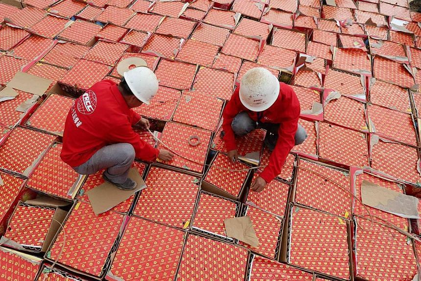Workers preparing to destroy boxes of illegal fireworks in Rongan, China's southern Guangxi province, on Wednesday. More than 600 boxes of illegal fireworks were destroyed as part of a campaign to improve public safety.
