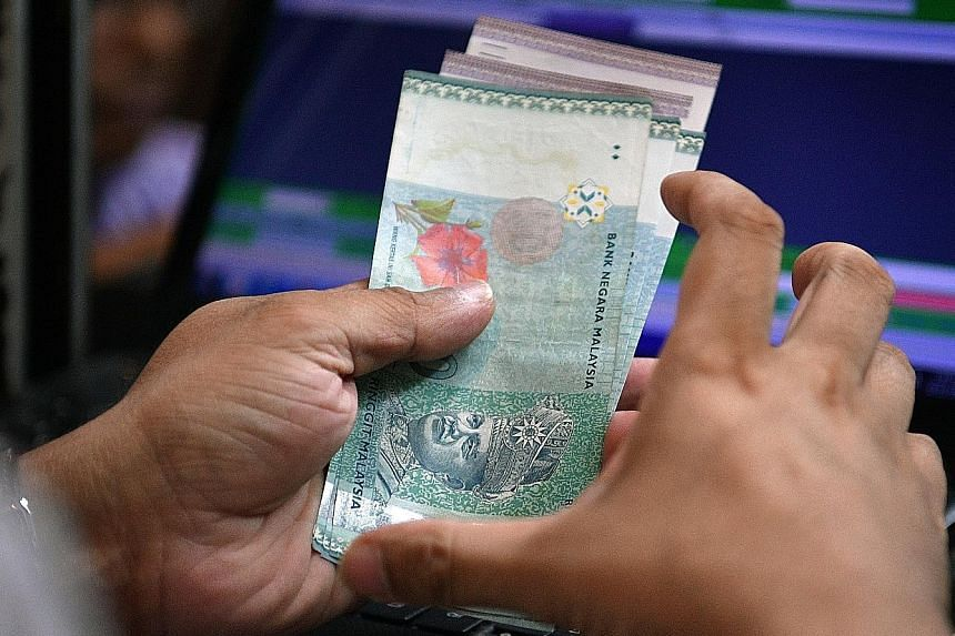 The ringgit fell nearly 1 per cent yesterday to a fresh 11-month low of 4.385 against the US dollar.
