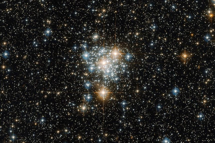This is an image of NGC 299, an open star cluster located within the Small Magellanic Cloud, just under 200,000 light years away. According to the European Space Agency, an open cluster such as this is a collection of stars weakly bound by the shackl