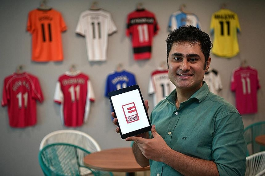 Shalu Wasu, Eleven Sports Network (Singapore) managing director, holding an iPad showing the start-up screen of the Eleven Sports app. Eleven hopes to expand its subscriber base with a slew of over-the-top sports content.