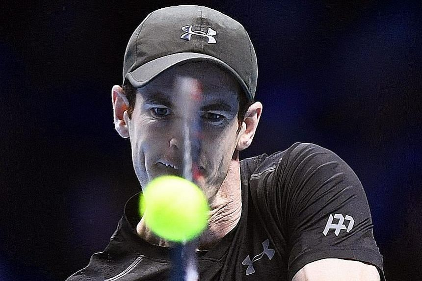 Britain's Andy Murray returns a backhand against Japan's Kei Nishikori at the ATP World Tour Finals in London on Wednesday. The world No. 1 triumphed 6-7 (9-11), 6-4, 6-4 in 3hr 20min and is likely to face Novak Djokovic in the final on Sunday in a m