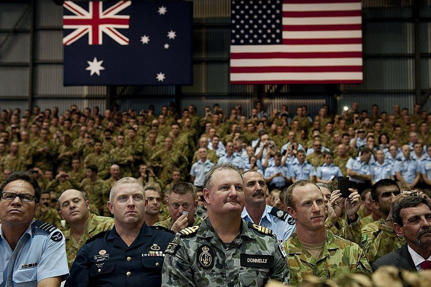 Australian troops and US Marines listening as Mr Obama gave a speech at the Royal Australian Air Force's Base Darwin in 2011. Australian troops have fought alongside the US' in each of its foreign wars.
