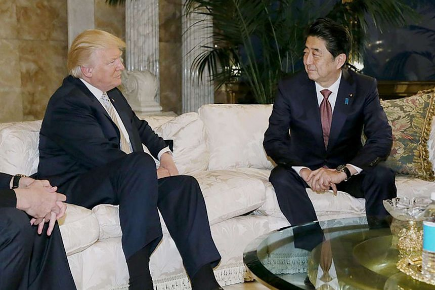 This handout picture, released by Japan's Cabinet Secretariat on Nov 18, 2016, shows Japanese Prime Minister Shinzo Abe (right) in a meeting with US president-elect Donald Trump (left) in New York.