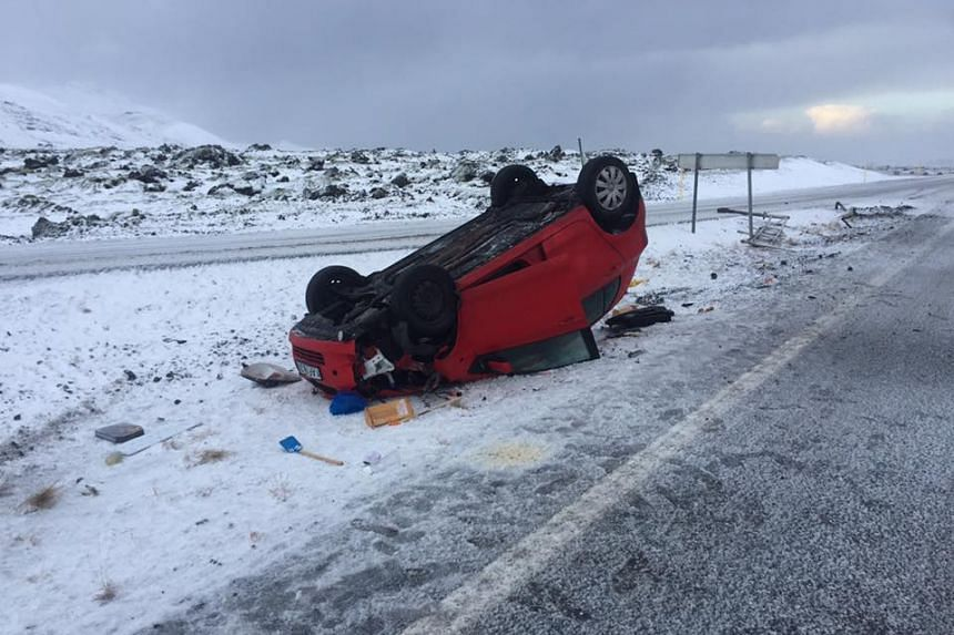 The red Toyota that overturned on an icy road, trapping the driver inside on Nov 15, 2016.