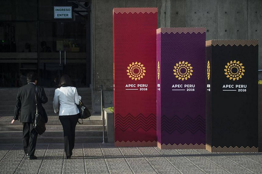 People arrive to the Lima Convention Centre during the Asia-Pacific Economic Cooperation (APEC) Summit on Nov 17, 2016.