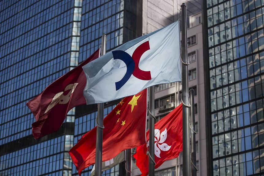 The flag of Hong Kong Exchanges & Clearing Ltd. (HKEx), the Chinese national flag, and the Hong Kong SAR flag, in the Central district of Hong Kong.