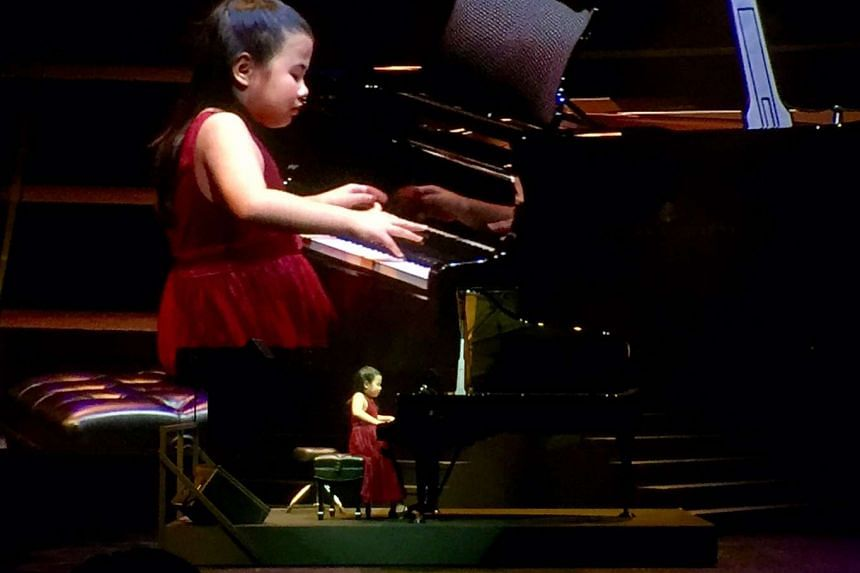 "Pianist Chen Jing playing Frederic Chopin's Waltz No. 1 in E Flat Major, Op 18 ""Grande Valse Brillante"" at the ChildAid concert on Friday (Nov 18)."