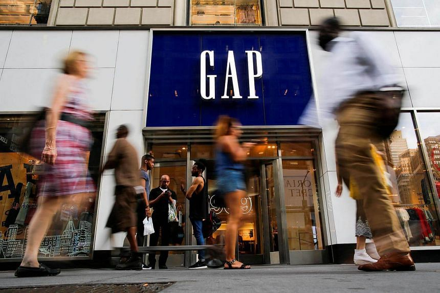 People pass by the GAP clothing retail store in Manhattan, New York.