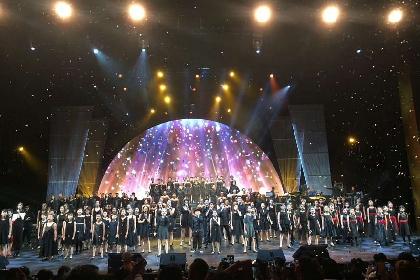 President Tony Tan and Mrs Tan went up on stage to meet performers and to present the cheque of over $2 million dollars raised for The Straits Times School Pocket Money Fund and the The Business Times: Budding Artists Fund on Friday (Nov 18).
