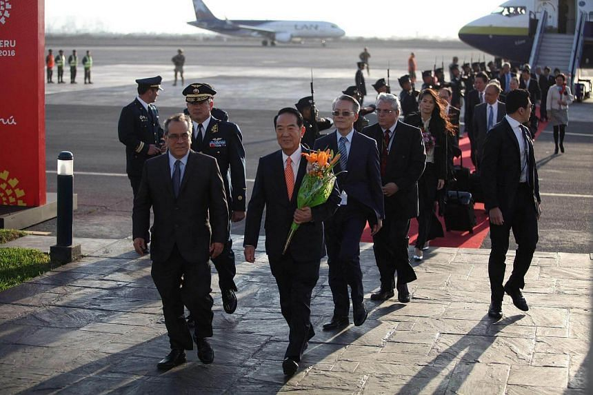 Taiwan's representative James Soong (centre) arriving at Lima's international airport ahead of the Asia-Pacific Economic Cooperation Summit.