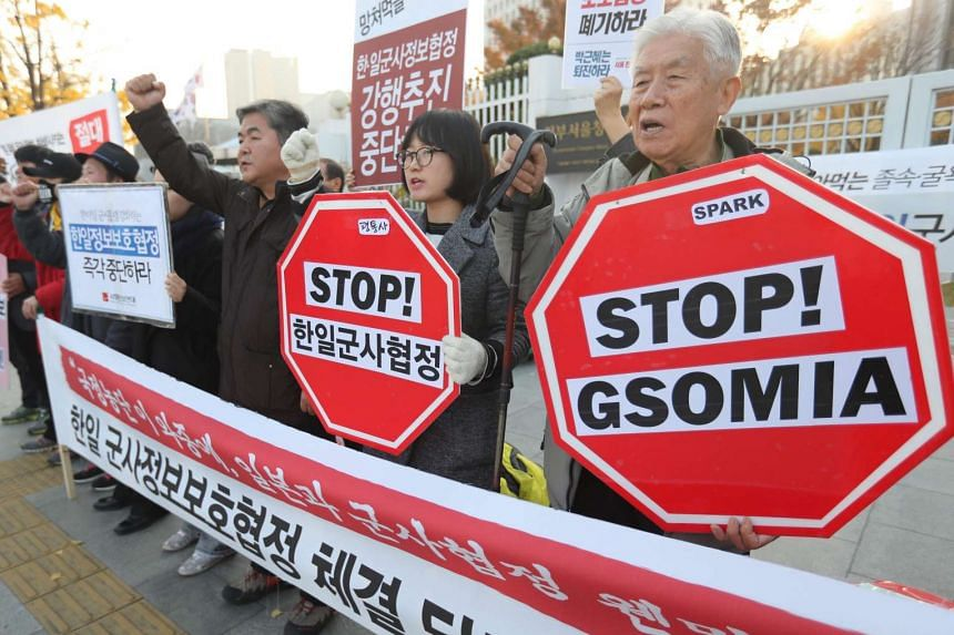 Activists hold a rally in front of the government complex in Seoul, South Korea on Nov 17, 2016, to call on the government to stop its push for a formal agreement with Japan on the sharing of military intelligence on North Korea.