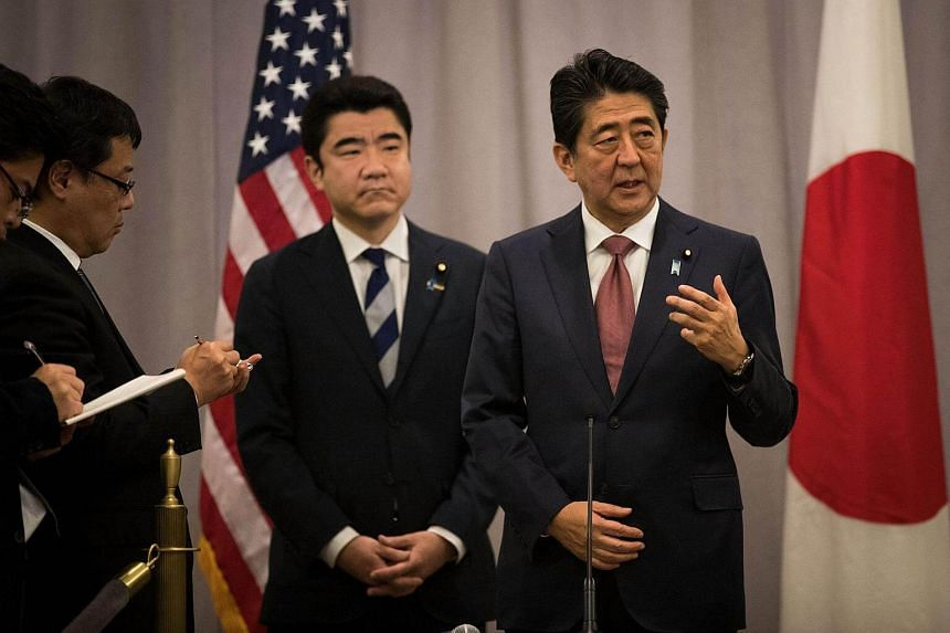 Prime Minister of Japan Shinzo Abe speaks to reporters following a meeting with President-elect Donald Trump on Nov 17, 2016 in New York City.