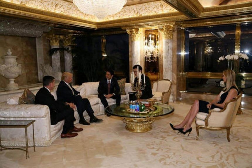 Japan's Prime Minister Shinzo Abe (third from left) meeting with US President-elect Donald Trump at Trump Tower in Manhattan, New York.