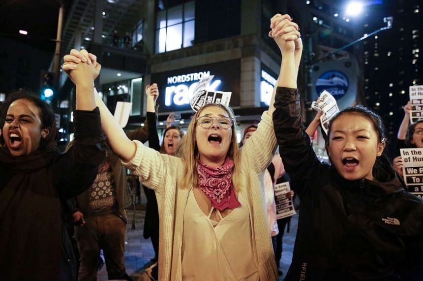 People march in protest against US President-elect Donald Trump in Seattle, Washington on Nov 14, 2016. Protesters have denounced Trump's often-inflammatory campaign rhetoric about immigrants, Muslims and women.