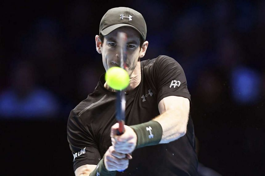 Britain's Andy Murray returns the ball to Japan's Kei Nishikori during their men's singles match at the ATP World Tour Finals tennis tournament at the O2 Arena in London, Britain,  Nov 16, 2016.