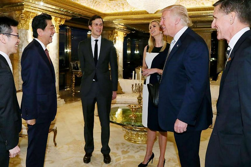 Donald Trump (second right) meeting Japanese Prime Minister Shinzo Abe (second left) on Nov 18, 2016, in New York.