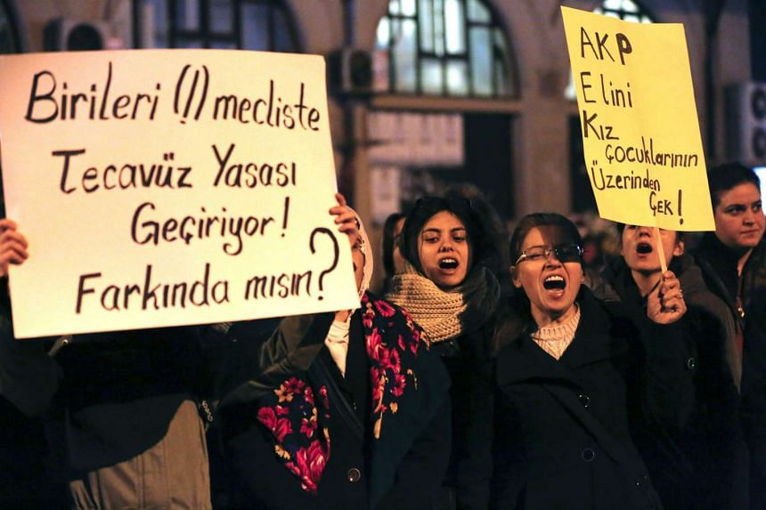 Turkish female protestors shout slogans against the government holding placards reading on 'AKP (Turkey's ruling party), stay away from female children' in Istanbul, Turkey on Nov 18, 2016.