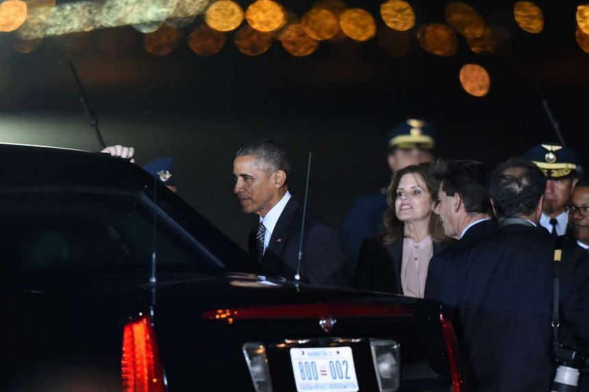 Obama (left) gets into his car as Peru's Vice-President Mercedes Araoz looks on upon his arrival at Jorge Chavez International Airport in Lima.