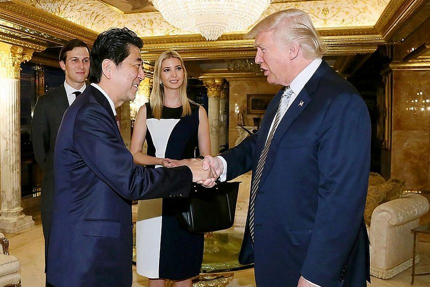 Mr Abe being welcomed by Mr Trump in New York on Thursday. With them were Mr Trump's daughter Ivanka and his son-in-law and adviser Jared Kushner. The meeting partially lifted the cloud of uncertainty that had been cast over ties between the two alli