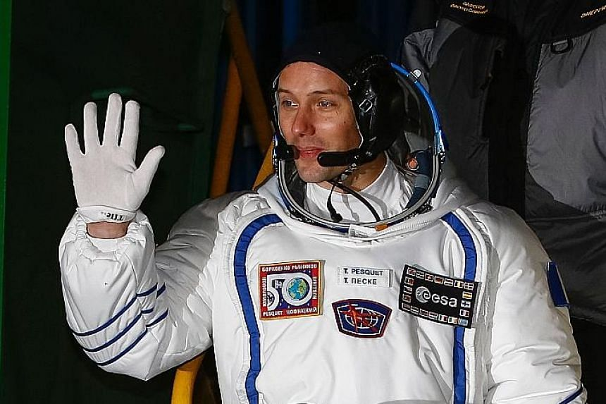 French astronaut Thomas Pesquet (at top), US astronaut Peggy Whitson and Russian cosmonaut Oleg Novitskiy will spend six months on the International Space Station.
