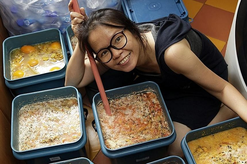 Volunteer Ng Wai Sen (left) with her homemade garbage enzymes she uses for cleaning purposes. At Eco-harmony cafe (right), which is part of charity and education foundation Kampung Senang, its staff uses garbage enzymes to wash dishes.