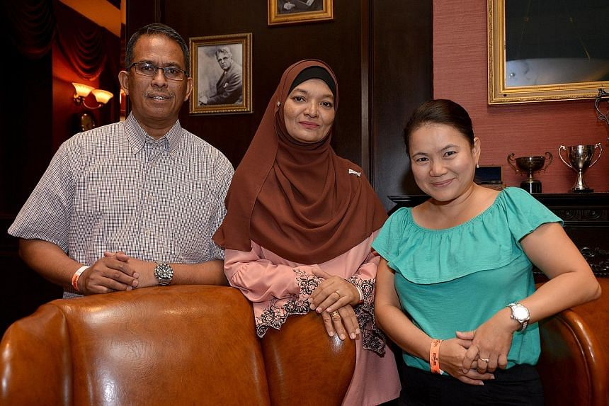 Retiree Azman Asmat and his wife Maimunah Dolah have cared for three foster children since 2008. Next to them is adjunct polytechnic lecturer Stacey Low, who took in a pair of two-year-old twins in July.