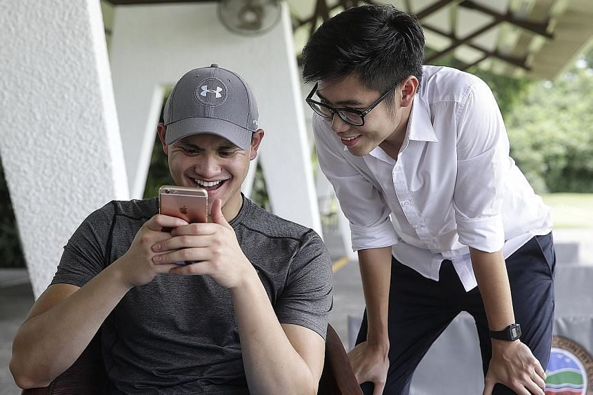 The swimming star with ST reporter Chua Siang Yee at TMCC, where he will take part in a Singapore Swimming Association golf fund-raiser on Tuesday. Schooling posing for photos with members of his extended family at Roland Restaurant last night. The 2