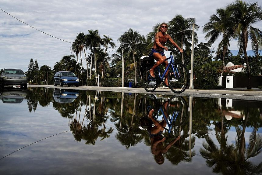 A street on Monday flooded with sea water caused by an annual so-called king tide in Fort Lauderdale, a city on Florida's south-eastern coast. King tides, which happen frequently, are the most blatant example of the interplay between rising seas and