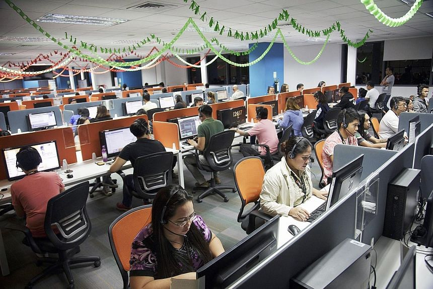 Employees at the 24/7 Customer Philippines Inc call centre in Cebu. More than half of call centres in the Philippines are American-owned, accounting for nearly three-fourths of the outsourcing industry's earnings. They employ more than a million work