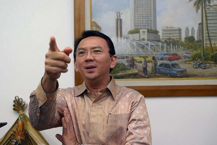 Ahok, shown here in a 2014 file photo, says his rivals are capitalising on his being both Chinese and Christian but he still has the support of Muslims among the Jakarta voters.