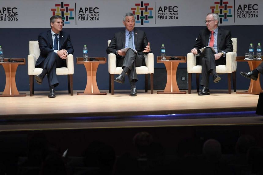 PM Lee Hsien Loong (centre) speaking at the CEO Summit on Nov 18, 2016. With him are the other panel speakers Mr Robert E. Moritz, chairman of PwC Global (left) and Mr Stephen McIntosh, Group Executive Growth and Innovation at Rio Tinto.