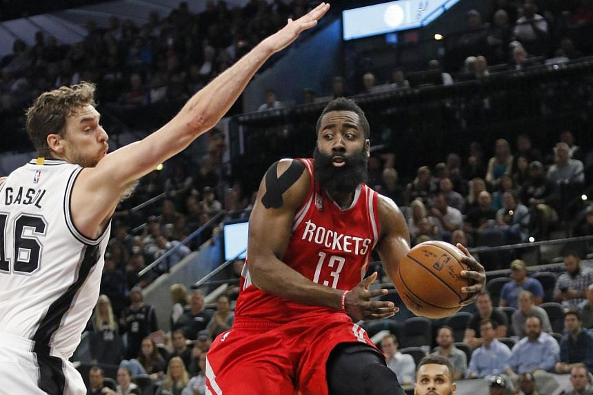 James Harden #13 of the Houston Rockets drives past Pau Gasol #16 of the San Antonio Spurs at AT&T Centre on Nov 9, 2016.