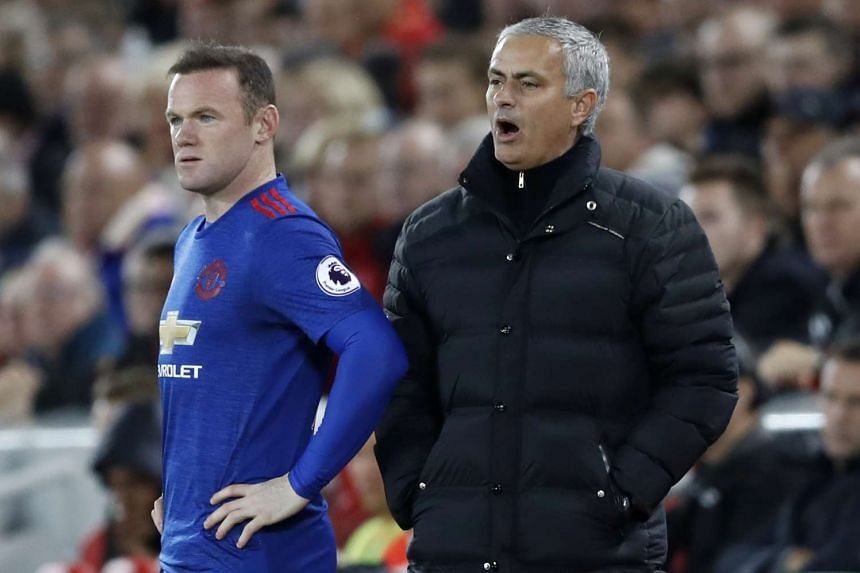 Manchester United's Wayne Rooney prepares to comes on as Jose Mourinho looks on, during a Premier League match against Liverpool on Oct 17, 2016.