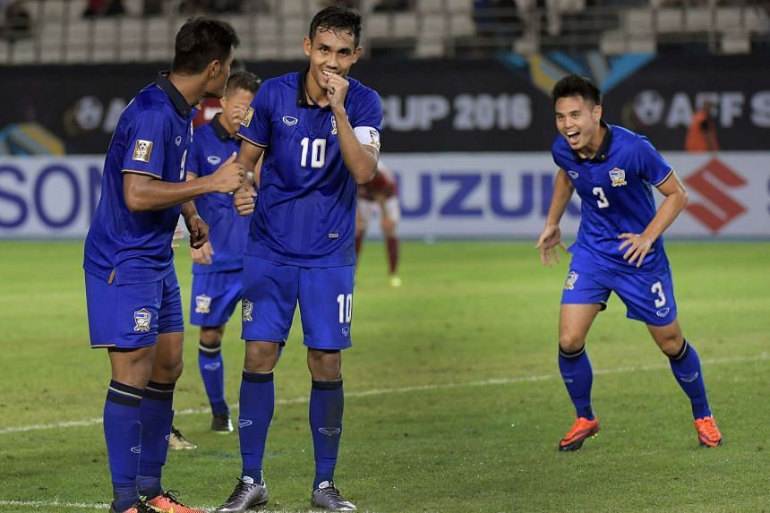 Thailand's Teerasil Dangda (no 10) celebrates after scoring Thailand's third goal during the Suzuki Cup 2016 match against Indonesia at the Philippines Sports Stadium, Nov 19, 2016.