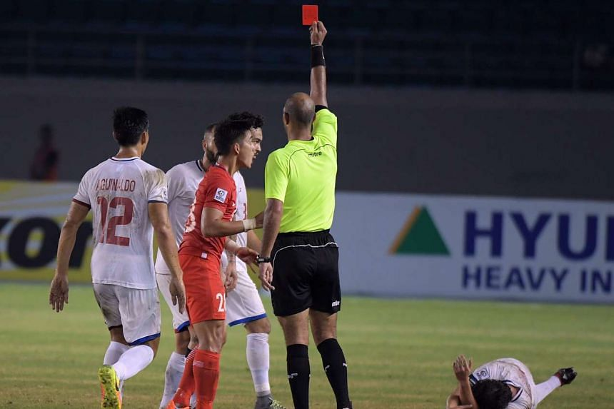 Singapore's Hafiz Sujad is given the red card during the Suzuki Cup 2016 match between Singapore and Philippines (white) at the Philippines Sports Stadium, Nov 19, 2016.