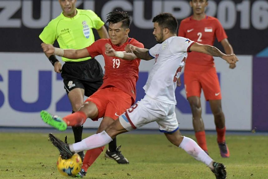 Khairul Amri (left) and Jeffrey Christiaens vie for the ball during the Suzuki Cup 2016 match between Singapore and Philippines (white) at the Philippines Sports Stadium, Nov 19, 2016.