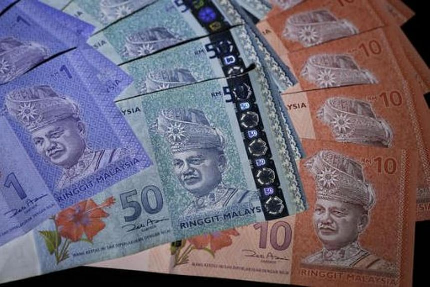 Malaysian ringgit banknotes of various denominations are arranged for a photograph in Tokyo.