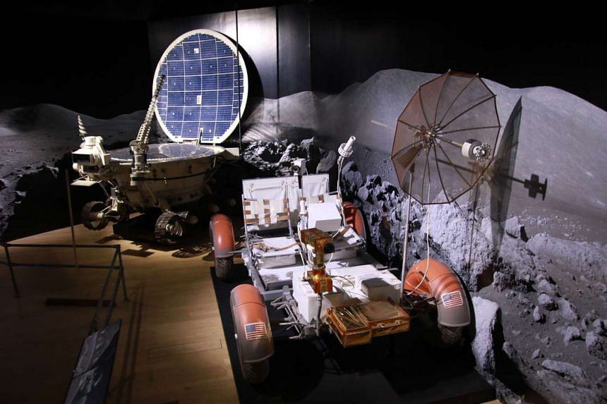 A full-scale replica of the Lunokhod 2 (left), a remote controlled lunar rover built by the Soviets between 1969 and 1977; and a full-scale replica of the Apollo Lunar Roving Vehicle (right), a battery-powered four-wheeled rover used on the moon in 1