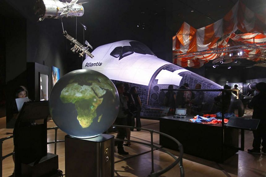 A full-scale replica of the Space Shuttle orbital vehicle (background).