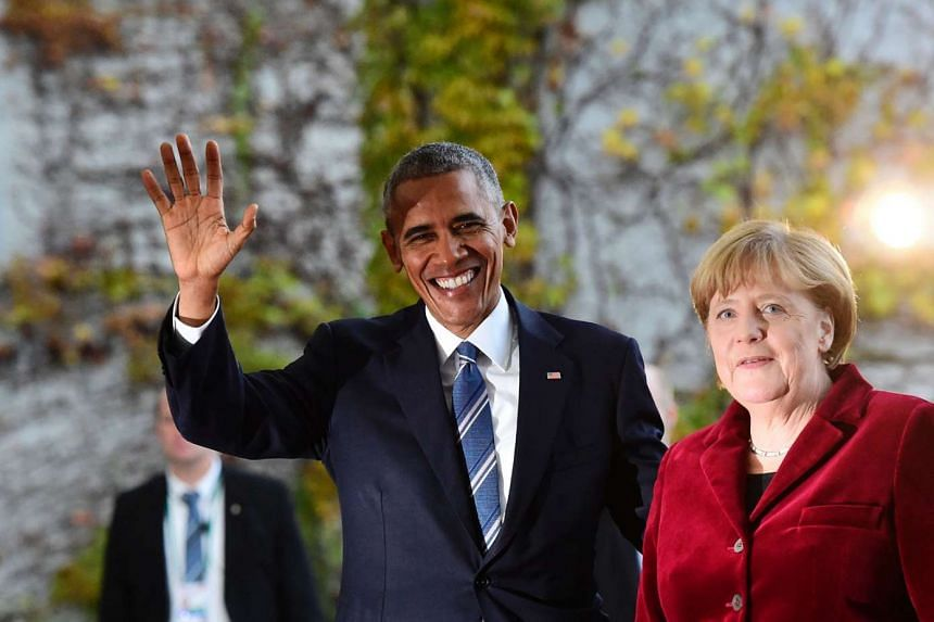 Mr Obama, who was on a farewell visit, being greeted by Dr Merkel in Berlin on Thursday.