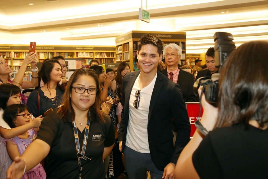 Joseph Schooling arrives for a book signing session for the photobook Hello, My Name Is Joseph Schooling at Kinokuniya, Ngee Ann City on Nov 20, 2016.
