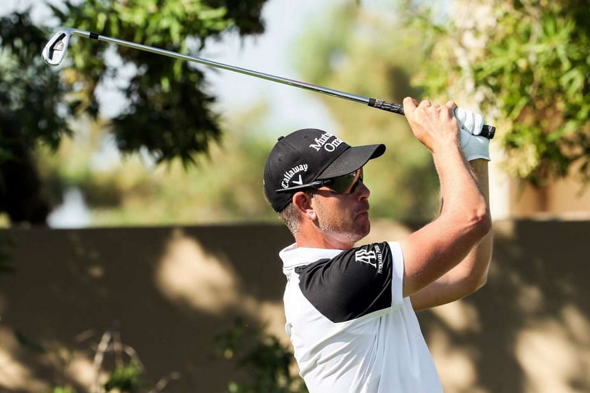 Henrik Stenson of Sweden plays a shot during day two of the DP World Tour Championship at Jumeirah Golf Estates in Dubai on Nov 18, 2016.
