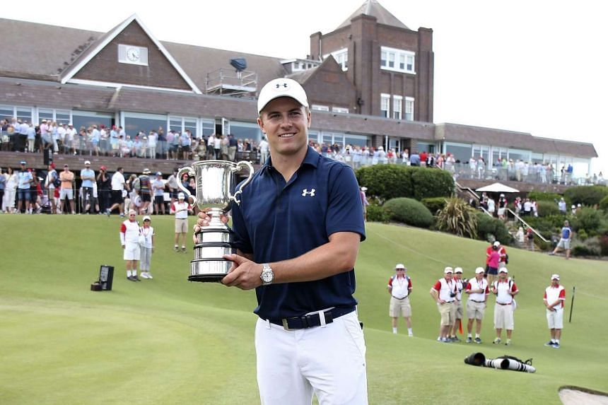 US golfer Jordan Spieth holds the Stonehaven Cup trophy after winning the Australian Open Golf Championship at the Royal Sydney Golf Club in Sydney on Nov 20, 2016.