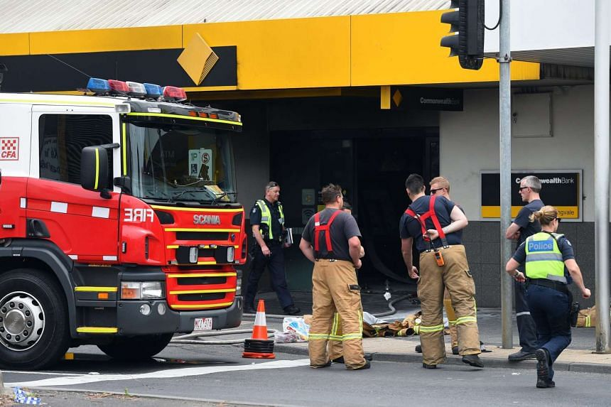 Emergency service workers at the Commonwealth Bank in Melbourne, Australia on Nov 18, 2016.