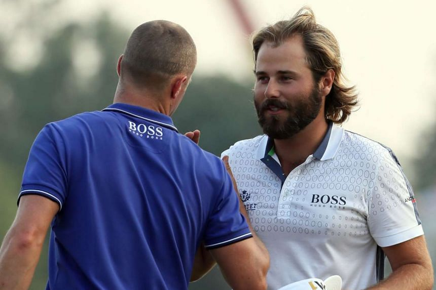 Victor Dubuisson (right) of France and Alexander Noren of Sweden exchange words during the third day.